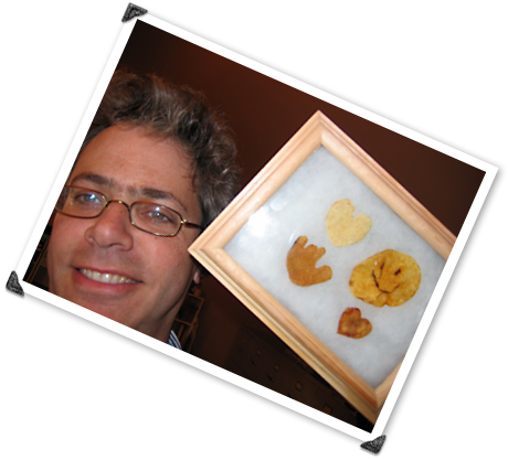 Allen shows off his framed collection of unusual potato chips.