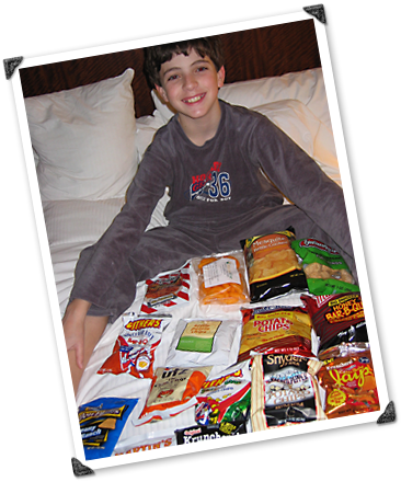 Max shows off a multitude of snacks.